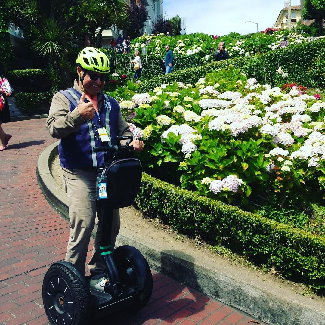 Fun segway tour picture of the day from @segwayworldwide and the Electric Tour Company in San Francisco Ca  Happy Thursday from SF. The flowers on Lombard street are starting to bloom. Only in San Francisco can you segway down the crookedest street. Glide down Lombard Street and up to Coit Tower on our Advanced rider tour. Perfect for experienced riders . Book today . . .